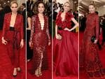 Red red wine tones ... Sienna Miller, Rose Byrne, Poppy Delevingne and Jessica Hart at the Met Gala 2015. Picture: Getty