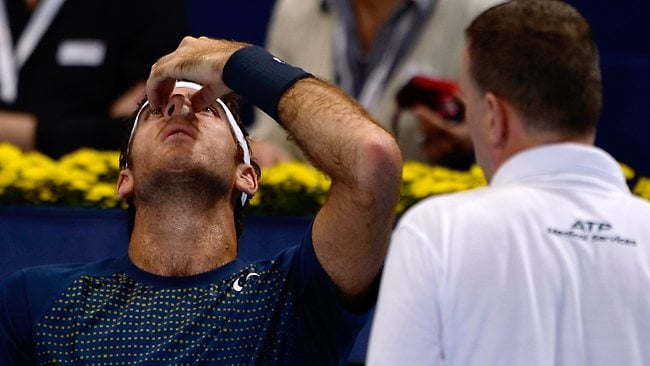 Argentina's tennis player Juan Martin Del Potro receives medical traitment during the Swiss Indoors ATP tournament in Basel.
