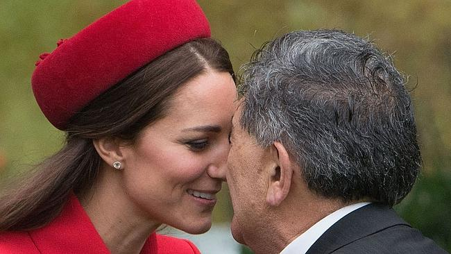 "Nose to see you: Catherine receives a ""hongi"", a traditional Maori greeting at Government House in Wellington. Picture: AFP PHOTO / MARTY MELVILLE"