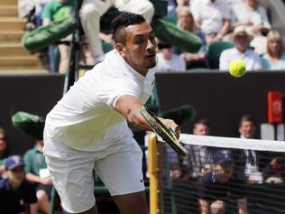 Nick Kyrgios of Australia returns the ball to to Radek Stepanek of the Czech Republic during their men's singles match on day two of the Wimbledon Tennis Championships in London, Tuesday, June 28, 2016. (AP Photo/Ben Curtis)