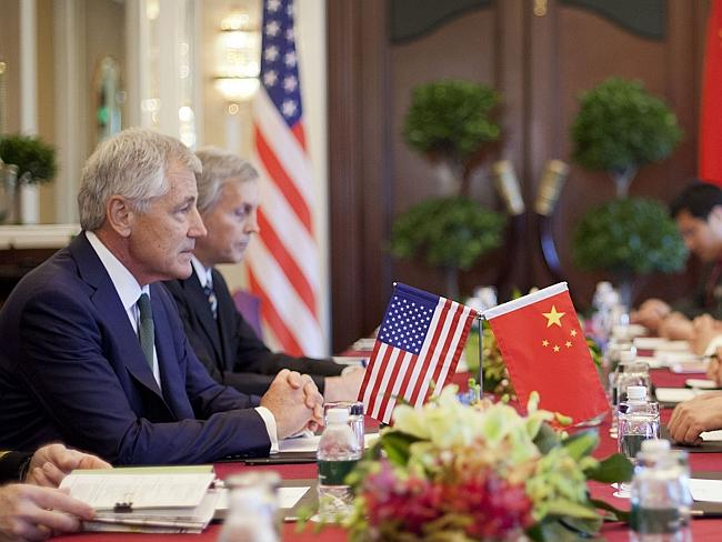 Tough talk... Hagel listens to the Chinese delegation at the start of their meeting in Si