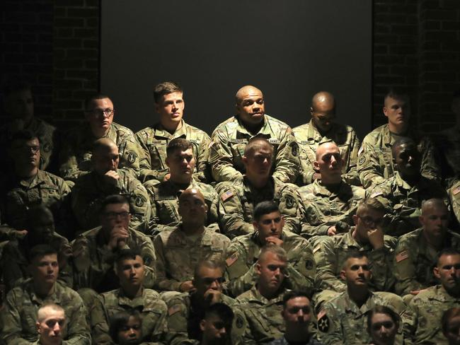 US military personnel listen to President Donald Trump deliver remarks on Americas involvement in Afghanistan at the Fort Myer military base. Picture: Getty