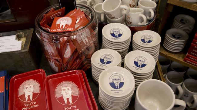Donald Trump trays and coffee cups are displayed alongside Bernie Sanders products at a home furnishings store. Picture: AP/Mary Altaffer