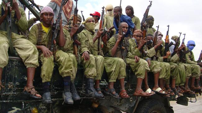 Al-Shabaab fighters sit on a truck as they patrol in Mogadishu, Somalia in 2013. Picture: AP/Mohamed Sheikh Nor.