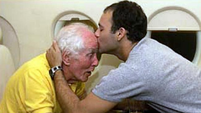 British fugitive criminal Great Train Robber Ronald (Ronnie) Biggs being kissed with son Michael on their way back to Britai...