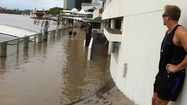 Eagle St Pier has been inundated in the Brisbane floods.