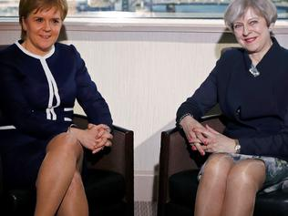 Britain's Prime Minister Theresa May (R) and Scotland's First Minister Nicola Sturgeon pose for a photograph ahead of their meeting in a hotel in Glasgow, on March 27, 2017. British Prime Minister Theresa May travelled to Scotland on Monday to try to avert its independence bid while also fighting a political crisis in Northern Ireland in the frantic final days before she launches Brexit. / AFP PHOTO / POOL / RUSSELL CHEYNE