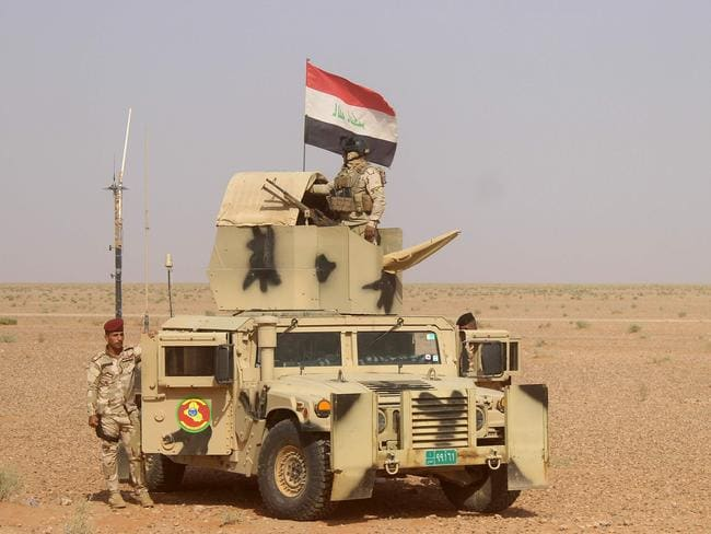 Troops are backed by militia recruited from the region's Sunni Arab tribes. Picture: AFP/Moadh Al-Dulaimi