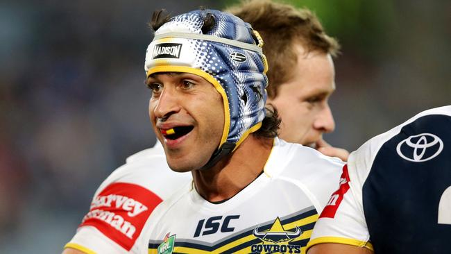 Cowboy's Johnathan Thurston all smiles after a try against the Bulldogs.