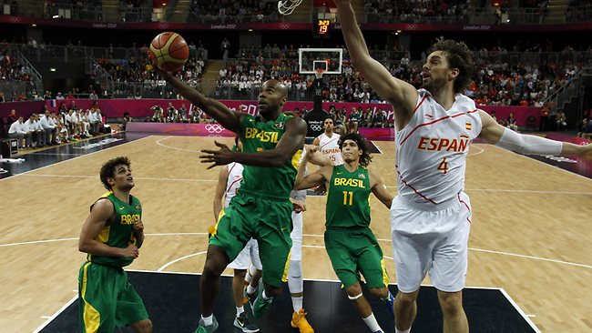 Quality ... LA Lakers star Pau Gasol (R) tries to block a lay-up from Brazil's Larry Taylor.