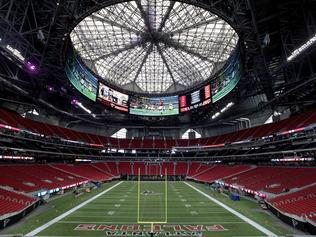 The Mercedes-Benz Stadium, the new home of the Atlanta Falcons football team and the Atlanta United soccer team, nears completion in preparation for its opening in Atlanta, Tuesday, Aug. 15, 2017. The stadium will open to the public for the first time at an Aug. 26 Falcons preseason game. (AP Photo/David Goldman)