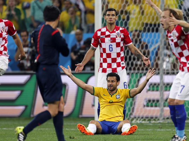 Dejan Lovren (6) just can't believe it and neither can most people, as referee Yuichi Nishimura, from Japan, points to the spot in the opening game of FIFA World Cup 2014 in Brazil. Picture: AP/Frank Augstein