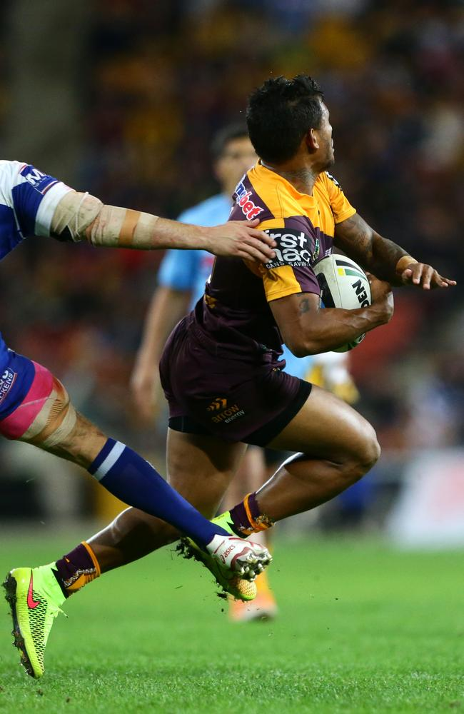 Ben Barba of Brisbane tripped by Josh Reynolds of the Bulldogs.