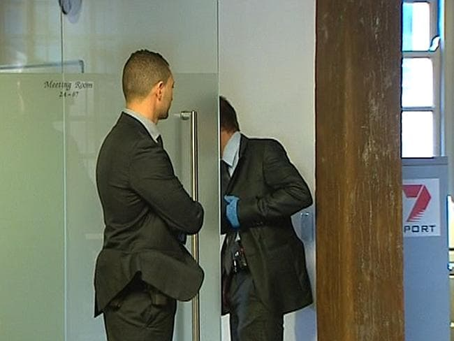 Members of the Australian Federal Police are seen in the Channel Seven Pyrmont offices in
