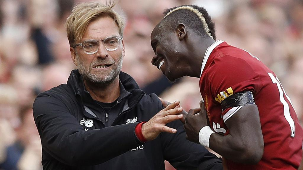 Liverpool's Sadio Mane, right, celebrates his goal with manager Jurgen Klopp.