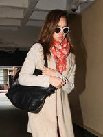 Jessica Alba tries to hide how sick she looks behind some cute white frames. Picture: Snappermedia