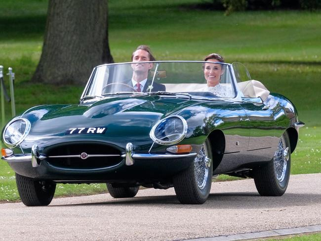 Just married ... Mr and Mrs Matthews leave Englefield house in the vintage Jag.