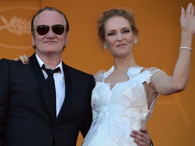 Finally together ... US director Quentin Tarantino and actor Uma Thurman get close at the Cannes Film Festival on May 24. The long-time friends are now dating, reports say. Picture: AFP