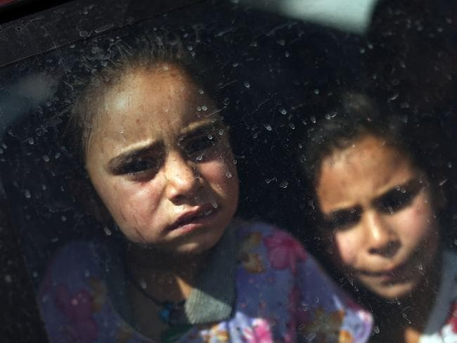 Iraqi children look out of the window of their car as they wait to get into a temporary displacement camp in Khazair, Iraq, last Thursday. Photo: Spencer Platt