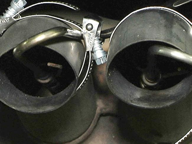 The tailpipe of a Volkswagen Jetta is tested in North Carolina as regulators have not ruled out a recall on certain brands of the car. Picture: AP Photo/Allen G. Breed, File.