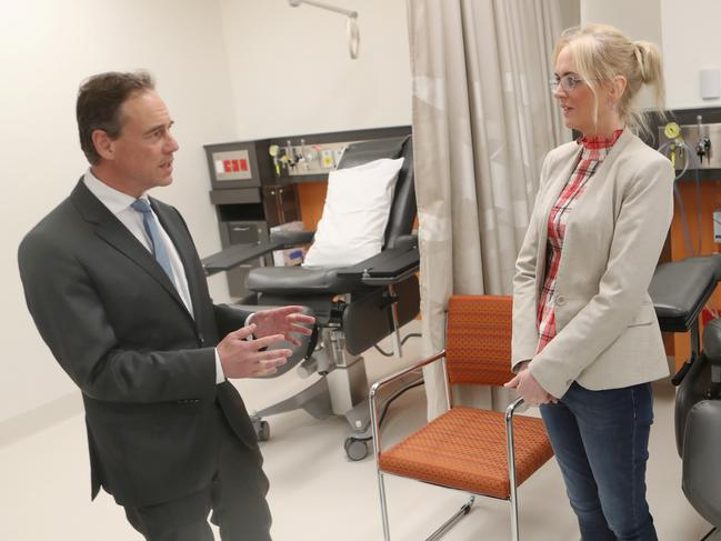 Health Minister Greg Hunt speaks to Hodgkin's lymphoma patient Alison Beninati in Melbourne as he announced the listing of medicine to treat the cancer on the PBS. Picture: AAP Image/David Crosling