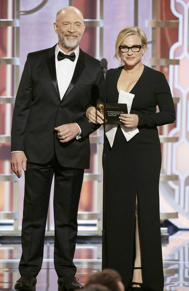 Presenters J.K. Simmons and Patricia Arquette speak onstage during the 73rd Annual Golden Globe Awards at The Beverly Hilton Hotel on January 10, 2016 in Beverly Hills, California. (Photo by Paul Drinkwater/NBCUniversal via Getty Images)