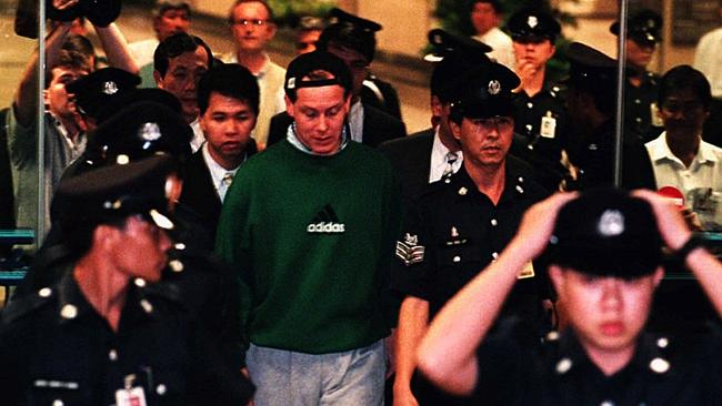 Nick Leeson arrives at Singapore's Changi Airport after being extradited from Germany to face fraud and charges.
