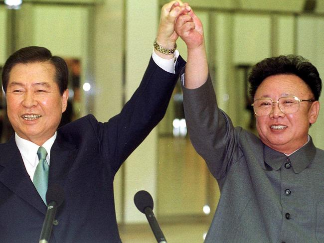Kim Dae-jung and Kim Jong-il raise their arms together before signing a joint declaration at the end of the second day of a three-day summit in Pyongyang. Picture: Yonhap/AP