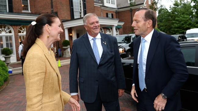 Tour meetings ... Tony Abbott is greeted by ambassador Kim Beazley and his wife Susie during his arrival at the ambassador's residence in Washington DC for a tree planting ceremony. Picture: Jake Nowakowski