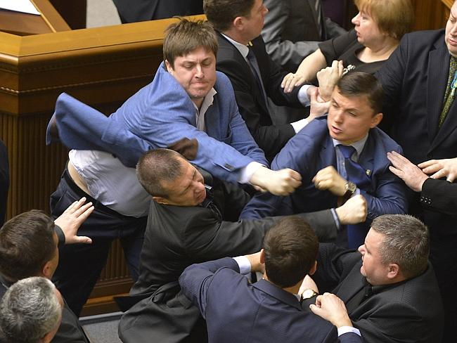 Parliament fight... Communist lawmakers scuffle with right-wingers in the Ukrainian parli