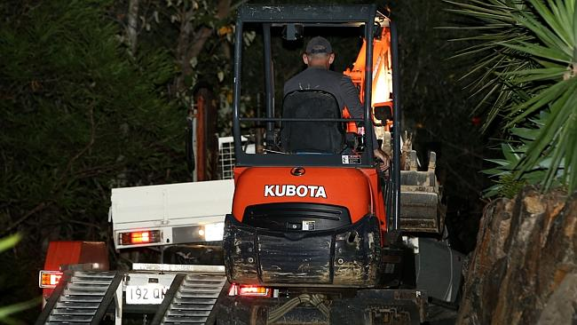 Police at a property at Mt Nathan, where they issued a warrant to dig up an area of the backyard in relation to the disapperance of Novy Chardon. Picture: David Clark