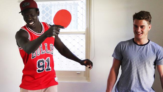 Aliir Aliir and Tom Papley at their home in Sydney. Picture. Phil Hillyard