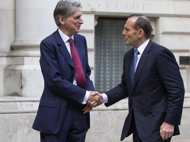 Talks...British Foreign Minister Philip Hammond greets Mr Abbott outside the Foreign & Commonwealth Office in London. Picture: Getty