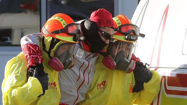 Emergency services personnel wearing protective clothing participate in the drill. Picture: Chung Sung-Jun./Getty)