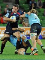 On easy way through ... Rebel Scott Fuglistaller is tackled by the Waratahs' Michael Hooper. Picture: Andrew Henshaw