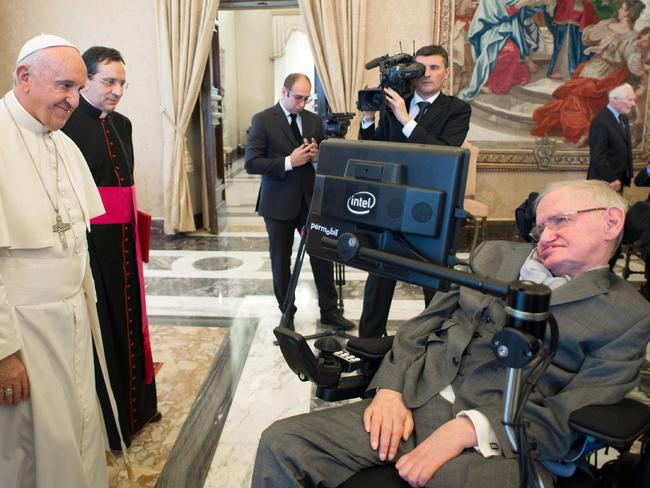 Pope Francis greets physicist Stephen Hawking in 2016 at the Vatican. Picture: L'Osservatore Romano/AP
