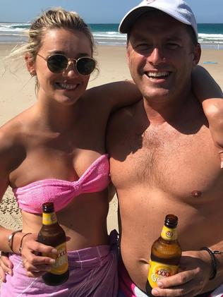 Karl and Jasmine having a couple of cold ones at the beach. Picture: Instagram