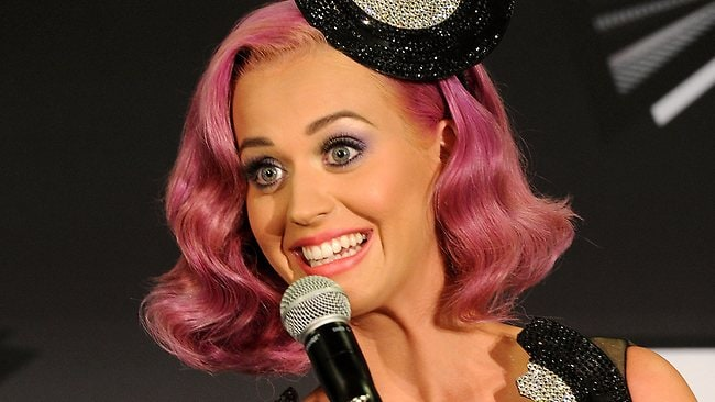 """LOS ANGELES, CA - AUGUST 28: Singer Katy Perry, winner of the Video of the Year Award for 'Firework"""", Best Collaboration Award (featuring Kanye West) for """"E.T."""" and Best Special Effects in a Video for """"E.T."""" poses in the press room during the 2011 MTV Video Music Awards at Nokia Theatre L.A. LIVE on August 28, 2011 in Los Angeles, California. Jason Merritt/Getty Images/AFP== FOR NEWSPAPERS, INTERNET, TELCOS & TELEVISION USE ONLY =="""