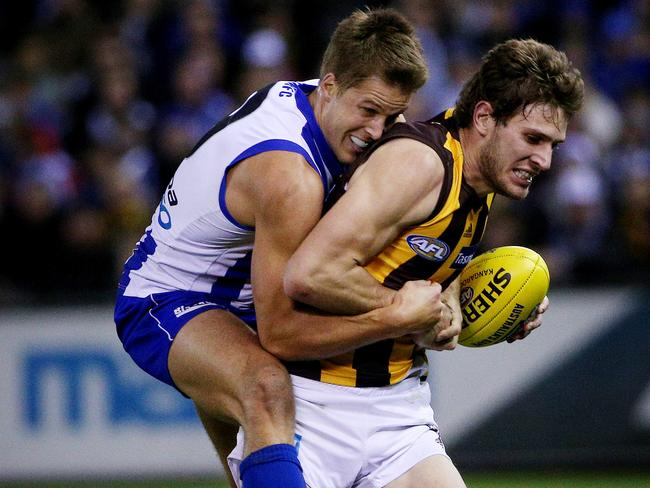 North Melbourne's Andrew Swallow leads by example. Picture: Colleen Petch