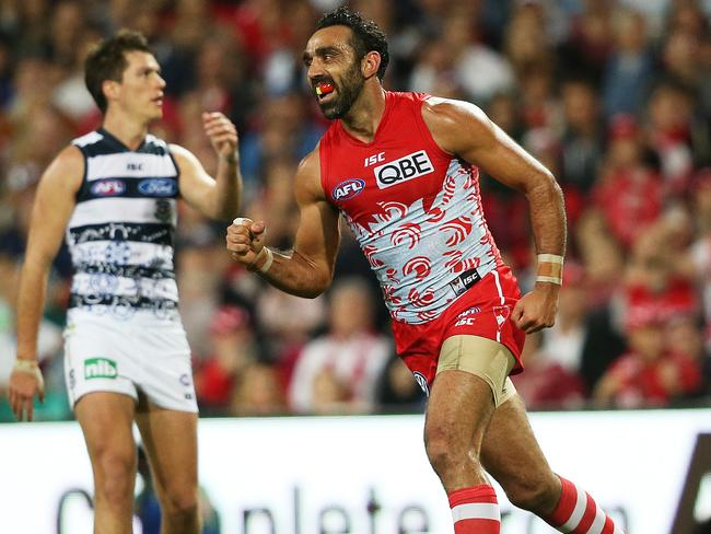 Adam Goodes roves a pack to kick a classic goal. Pic. Phil Hillyard