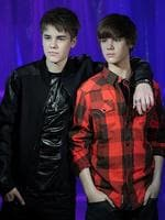 Smaller than the real thing ... Canadian popstar Justin Bieber poses with his waxwork model as it is unveiled at Madame Tussauds museum in central London, on March 15, 2011. Picture: AFP PHOTO/CARL COURT