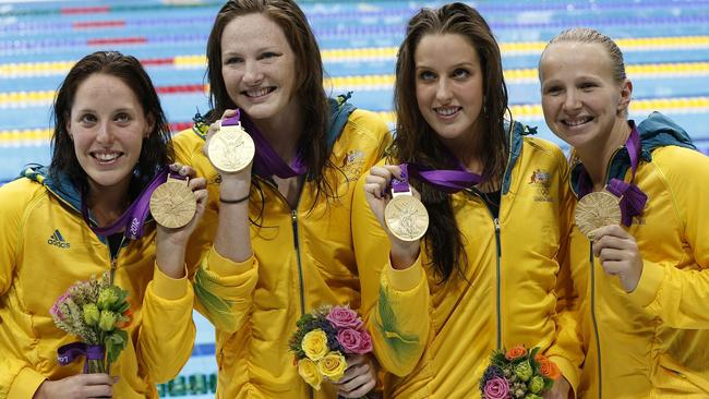 Alicia (left) with fellow relay champions Cate Campbell, Brittany Elmslie and Melanie Schlanger with their gold medals at the London Olympics. Picture: Barbara Walton