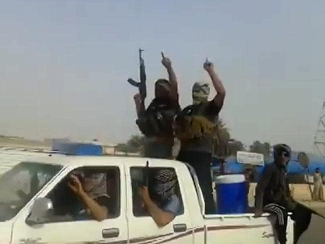 Occupation ... an image grab allegedly shows militants from the Islamic State of Iraq and the Levant (ISIL) parading with their weapons in Beiji, where the country's main oil refinery has been attacked. Picture: YouTube/AFP