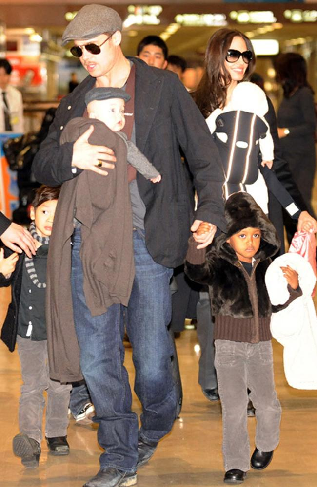 Travelling ... Brad Pitt and Angelina Jolie with their children at Narita International Airport, Japan in 2009. Picture: Supplied