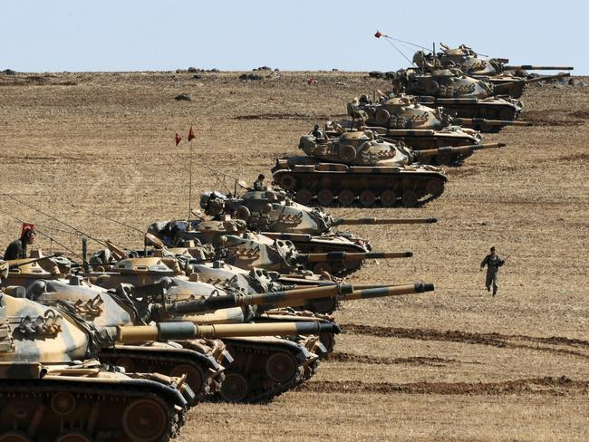 Heavily patrolled border ... Turkish army tanks take up position on the Turkish-Syrian border near the south-eastern town of Suruc, October 2014. Picture: Reuters / Umit Bektas