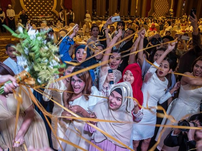 Wedding guests celebrate at the Al Meroz hotel in Bangkok, the city's first halal hotel. Picture: AFP/Roberto Schmidt