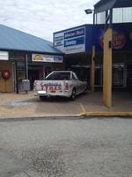 If you're going to make a #parkingfail, don't do it in the company ute. Courtesy Brisbane's Worst Parking on Facebook