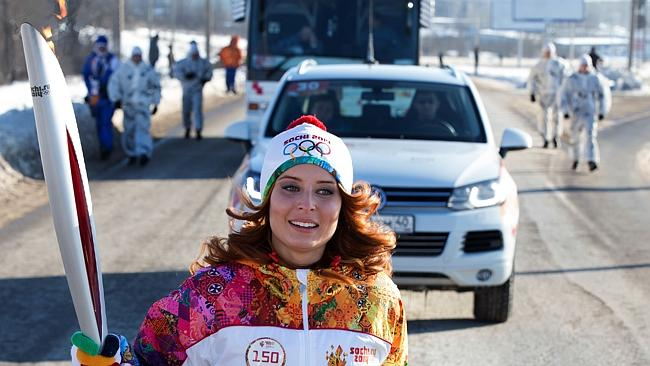 Aa torchbearer carrying an Olympic torch in the Volga River city of Volgograd, about 800km south of Moscow. History's longest Olympic torch relay ahead of Winter Games in Sochi, will take the flame across all 83 of Russia's regions.