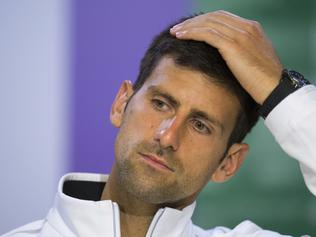 Serbia's Novak Djokovic gestures during a press conference after losing his Men's Singles Quarterfinal Match against Czech Republic's Tomas Berdych on day nine at the Wimbledon Tennis Championships in London, Wednesday, July 12, 2017. (AELTC, Joe Toth via AP)