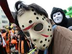 <p>People clad in special costumes pose for pictures as they walk on the street during the Halloween Parade in Kawasaki, suburb of Tokyo. Picture: AFP PHOTO/Toru YAMANAKA</p>